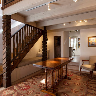 Example of a mountain style foyer design in Albuquerque with white walls