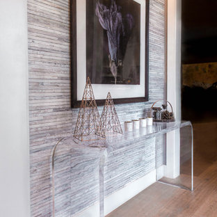 Inspiration for a small transitional light wood floor entryway remodel in Austin with purple walls and a white front door