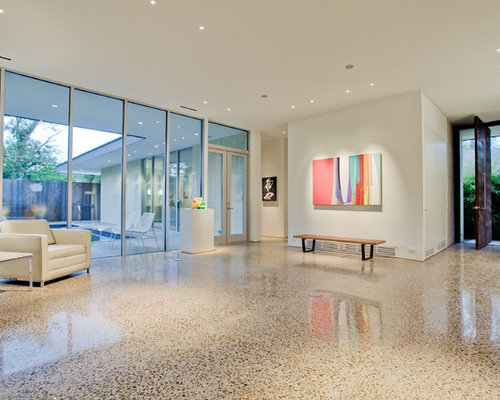 example of a minimalist entryway design in dallas with white walls
