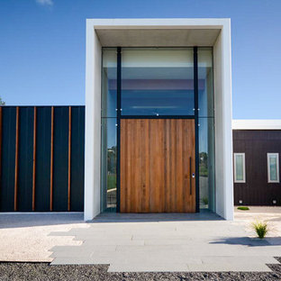 Inspiration for a contemporary front door in Hobart with a single front door and a medium wood front door.