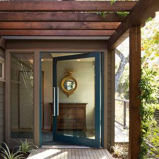 Entryway - contemporary ceramic floor entryway idea in San Francisco with a blue front door