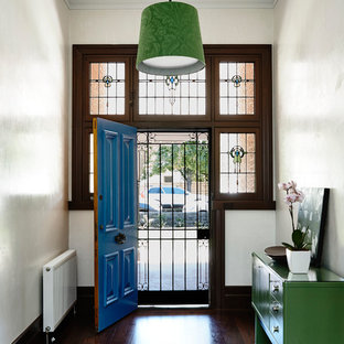Entryway - large contemporary dark wood floor entryway idea in Melbourne with white walls and a blue front door