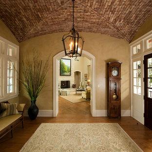 Large elegant vestibule photo in Charleston with beige walls