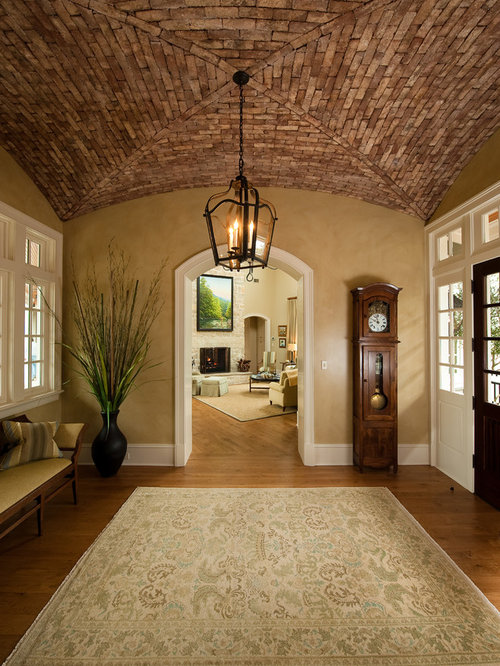 Large elegant vestibule photo in Charleston with beige walls - Cork Ceiling Houzz