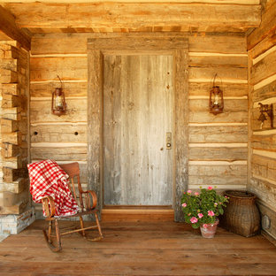 Inspiration for a mid-sized country front door in Denver with a single front door and a medium wood front door.
