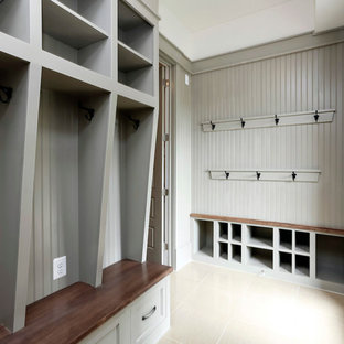 Inspiration for a mid-sized timeless linoleum floor entryway remodel in DC Metro with gray walls and a glass front door