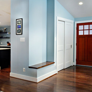 Photo of a small contemporary front door in DC Metro with a single front door, a medium wood front door, blue walls and dark hardwood flooring.