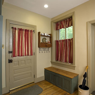 Inspiration for a mid-sized victorian light wood floor entryway remodel in Philadelphia with beige walls and a gray front door