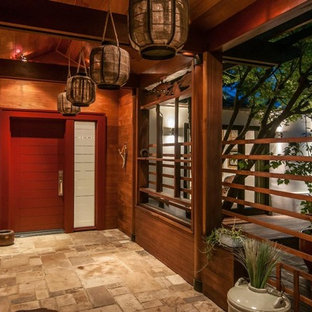 Entryway - entryway idea in Charlotte with a red front door