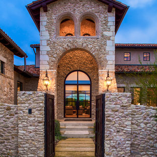 Tuscan double front door photo in Austin with a glass front door