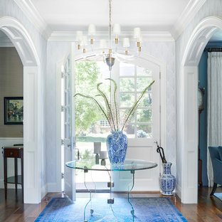 Inspiration for a mid-sized traditional foyer in Denver with medium hardwood floors, a double front door, a white front door, brown floor and grey walls.