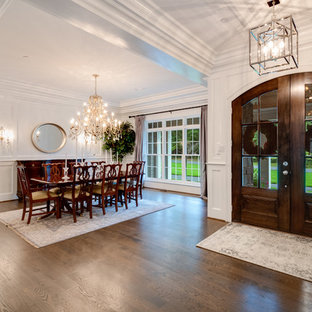 Entryway - mid-sized traditional dark wood floor and brown floor entryway idea in Baltimore with white walls and a glass front door