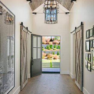 Farmhouse dark wood floor and brown floor single front door photo in San Diego with beige walls and a black front door