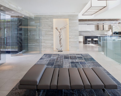 Inspiration For A Huge Contemporary Ceramic Floor Entryway Remodel In  Orange County With A Glass Front
