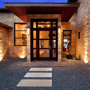 Mid-sized trendy slate floor entryway photo in Austin with a glass front door and beige walls