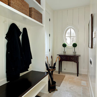 Example of a classic travertine floor mudroom design in Chicago with beige walls