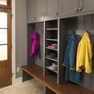 Country travertine floor mudroom photo in Minneapolis with gray walls