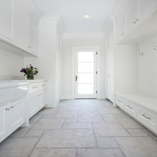 Inspiration for a large transitional ceramic tile and beige floor entryway remodel in Chicago with white walls and a white front door