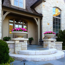 Traditional Exterior by Romani Landscape Architecture