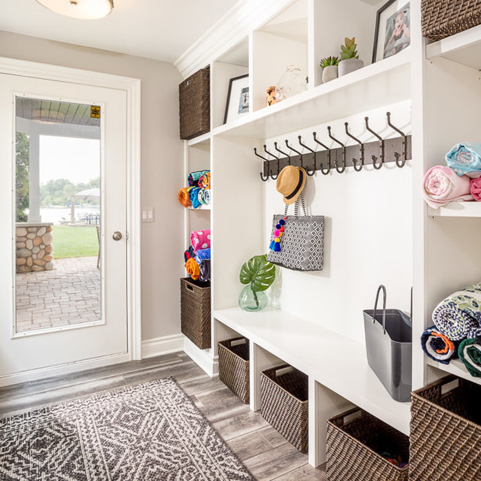 Our walk out basement needed a functional and easy access point for access to the lake by visitors and family members throughout the day. Open shelving for clean towel as well as storage hooks allow f
