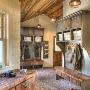 Mudroom - large rustic brick floor and multicolored floor mudroom idea in Minneapolis with beige walls