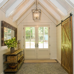 Inspiration for a mid-sized transitional granite floor entryway remodel in Toronto with white walls and a white front door