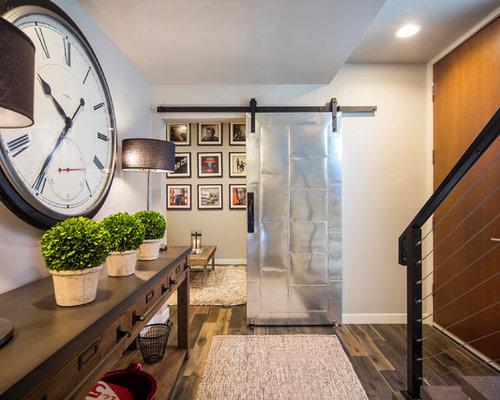 entryway transitional medium tone wood floor and brown floor entryway idea in seattle with beige - Foyer Design Ideas