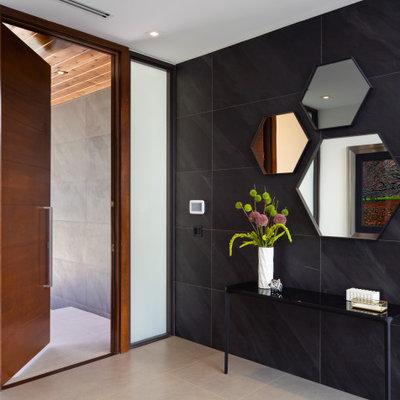 Single front door - contemporary gray floor single front door idea in Miami with a medium wood front door