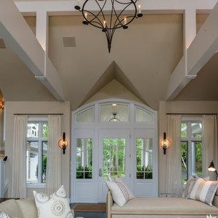 Ejemplo de puerta principal actual, grande, con paredes beige, puerta blanca, moqueta, puerta simple y suelo multicolor
