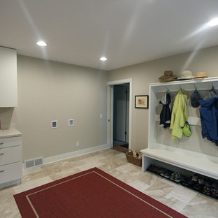 Inspiration for a large transitional travertine floor and beige floor entryway remodel in Other with gray walls and a white front door