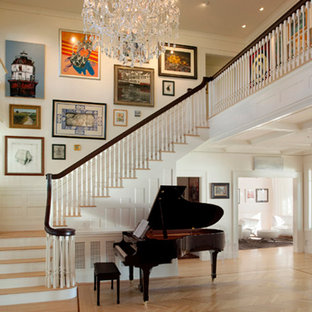 Example of a large classic light wood floor foyer design in Boston with white walls and a white front door