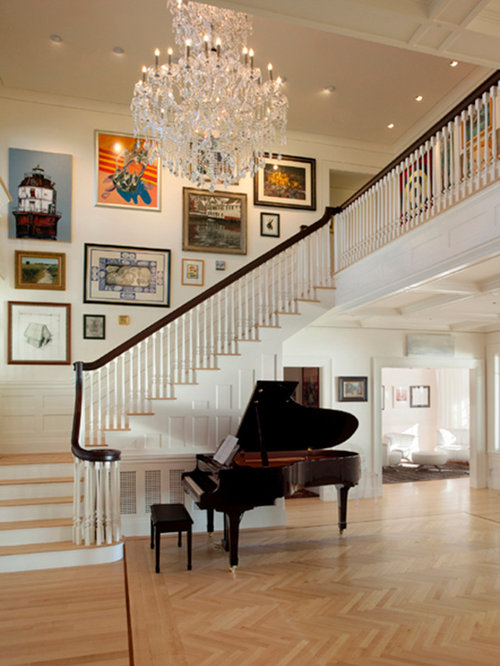 Example Of A Large Classic Foyer Design In Other With Light Hardwood