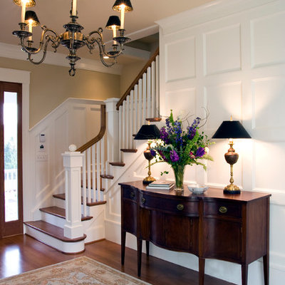 Foyer - large traditional medium tone wood floor and brown floor foyer idea in Richmond with beige walls