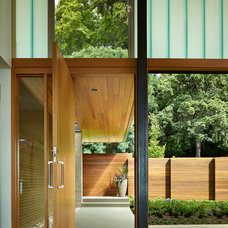 Contemporary Entry by Prestige Residential Construction