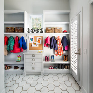 Example of a transitional entryway design in DC Metro with gray walls and a glass front door