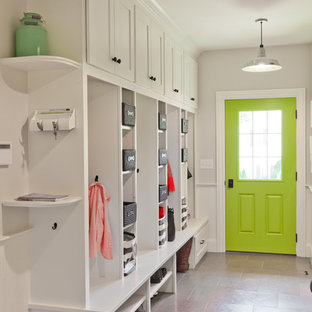 Example of a classic entryway design in Boston with white walls and a green front door