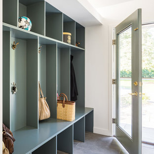 Mid-sized trendy slate floor and gray floor entryway photo in Boston with white walls and a glass front door
