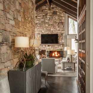 Design ideas for a small rustic foyer in Charlotte with white walls, dark hardwood flooring, a double front door and a medium wood front door.