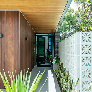 This is an example of a midcentury entryway in Perth.