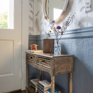 Inspiration for a small eclectic medium tone wood floor entryway remodel in San Francisco with gray walls and a white front door