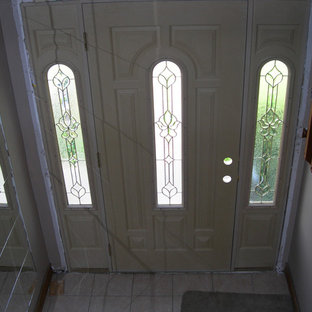 Entryway - mid-sized traditional entryway idea in Chicago with white walls and a white front door