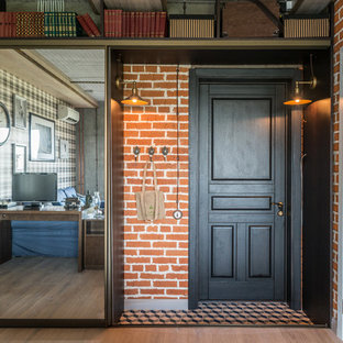 Mid-sized urban entryway photo in Moscow with brown walls and a black front door
