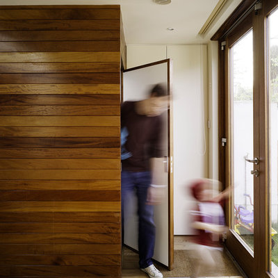 Example of a minimalist entryway design in Dublin with a glass front door