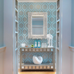 Design ideas for a beach style entry hall in Providence with blue walls and medium hardwood floors.