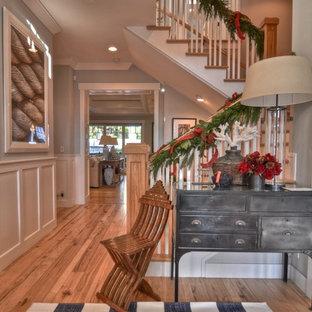 Entryway - transitional medium tone wood floor entryway idea in Los Angeles with blue walls