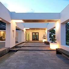 Modern Entry by Home & Commercial Designs