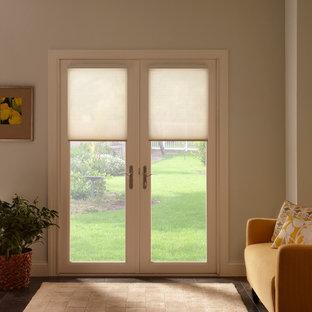 Inspiration för en mellanstor funkis ingång och ytterdörr, med blå väggar, klinkergolv i keramik, en dubbeldörr och en vit dörr