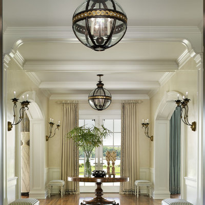 Foyer - large traditional foyer idea in New York with beige walls