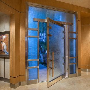 Свежая идея для дизайна: прихожая в восточном стиле с поворотной входной дверью - отличное фото интерьера