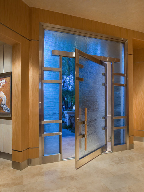 Glass and metal front door houzz example of a pivot front door design in phoenix planetlyrics Choice Image